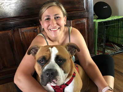 Prior Lake, MN pet sitter and dog walker with one of the dogs she cares for